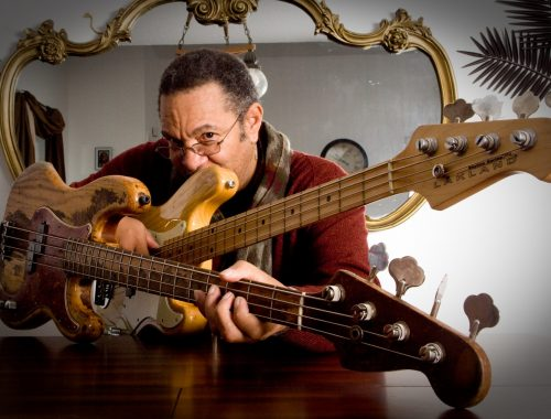 George Porter Jr holding bass guitar