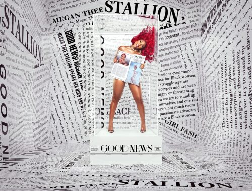 Megan Thee Stallion surrounded by newspapers