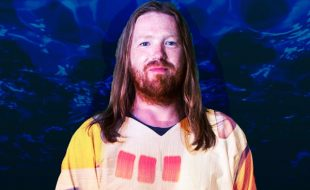 Reed Mathis against blue background press photo